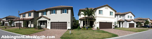 Tasteful homes and well-kept lawns are to be found within Lake Worth's gated Abbington community on Hupoluxo Rd.